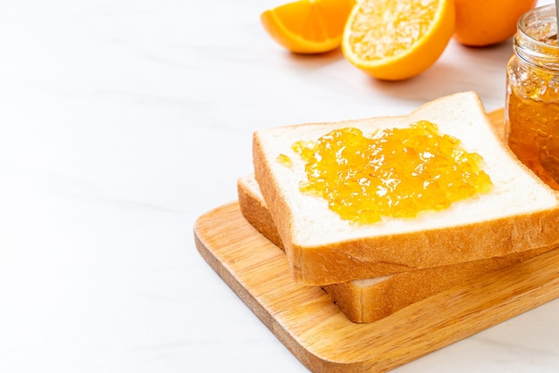 Slices of bread with orange jam for breakfast