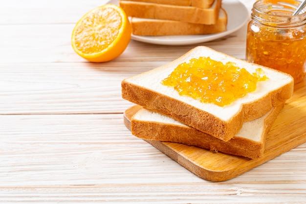 Slices of bread with orange jam
