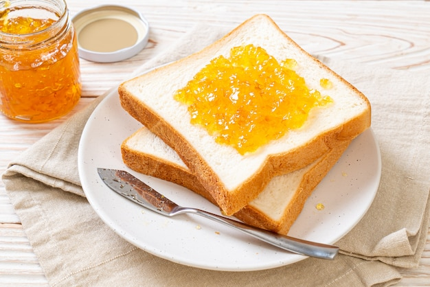 Slices of bread with orange jam