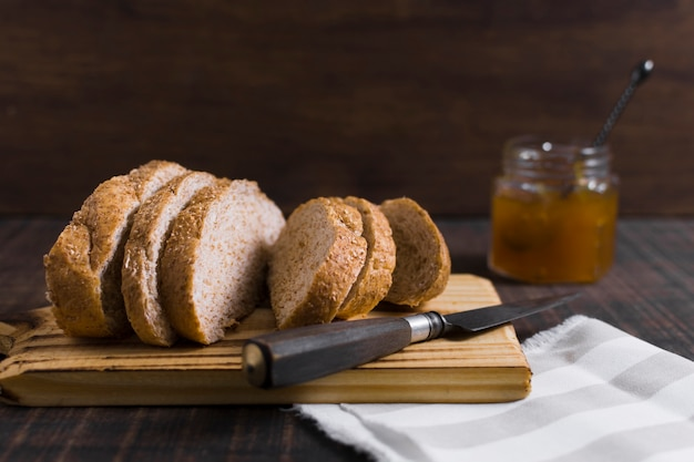 Slices of bread on wooden board with honey