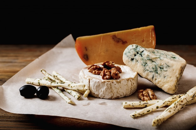 Slices of cheese brie or camembert with parmesan, cheddar ,blue cheese