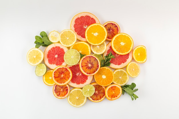Slices of citrus fruit in a pile