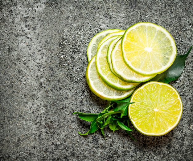 Slices of citrus fruits. top view. on rustic background