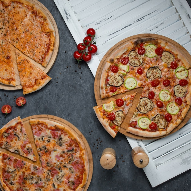 Slices cut from three varieties of pizzas