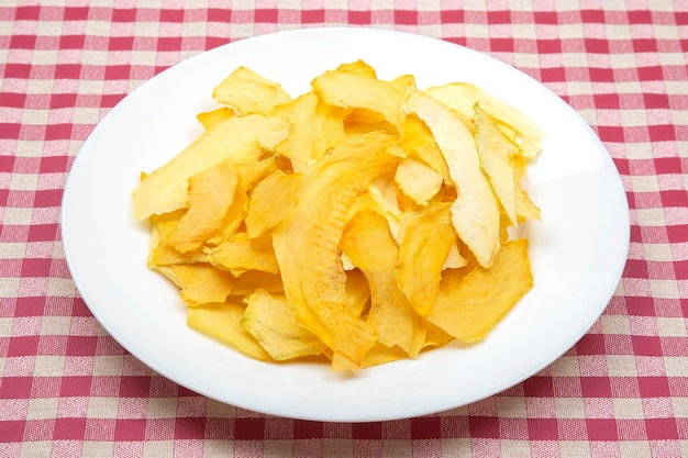 Slices of dried melon on a plate. fruits and vitamins