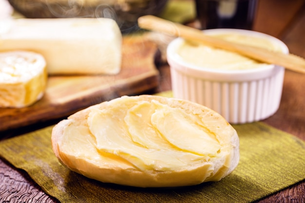 Slices of french bread, brazilian bread served hot, with lots of butter. called bald bread, baguette or brazilian baguette