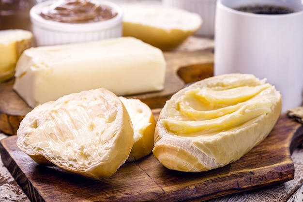 Slices of french bread, brazilian bread served warm, with butter. called salt bread or white bread