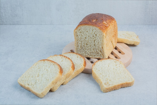 Slices of fresh bread on marble background. high quality photo