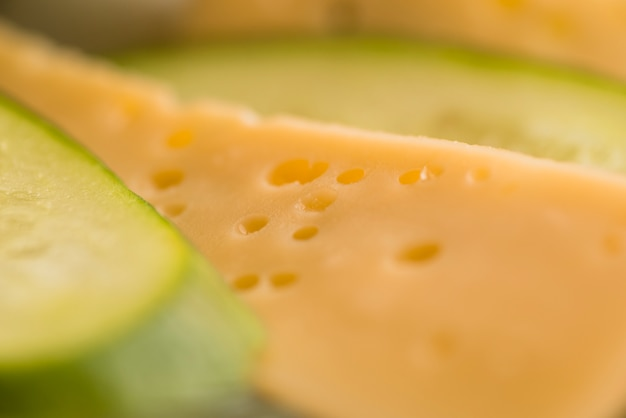 Slices of fresh cheese and cucumber