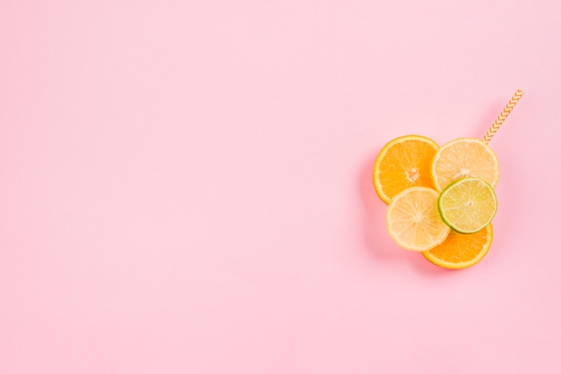 Slices of fresh citruses and straw