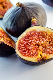 Slices of fresh figs on white background