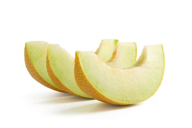 Slices of fresh melon isolated on white