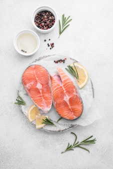 Slices of fresh salmon slices on white plate