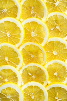 A slices of fresh yellow lemon texture background pattern
