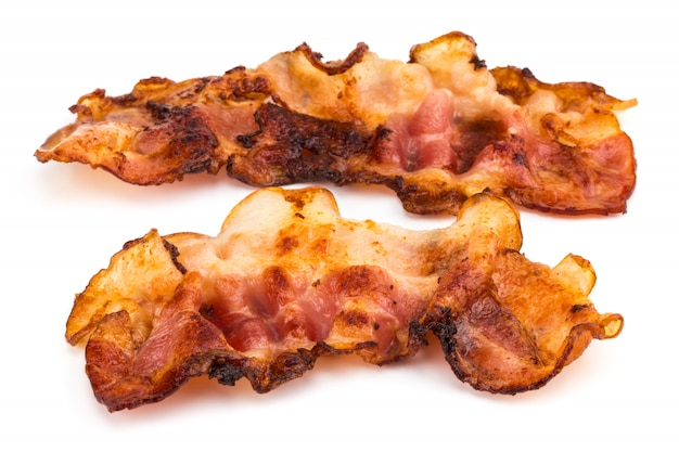 Slices of freshly fried bacon isolated on a white background