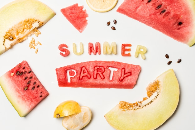 Slices of fruits near summer party title