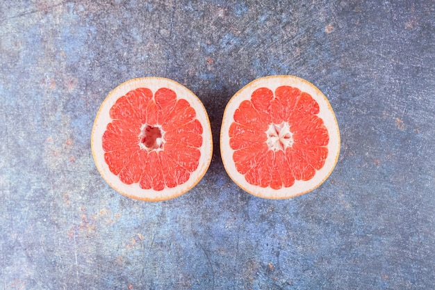 Slices of grapefruit placed on a stone table .