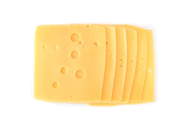 Slices of hard cheese with holes on a white background.