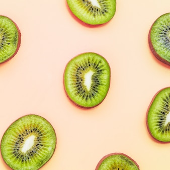 Slices of kiwi fruits on colorful background