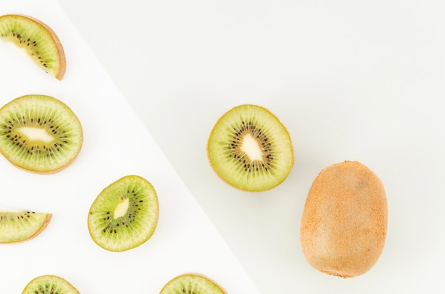 Slices of kiwi on light background