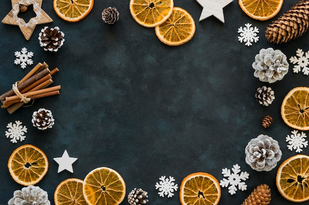 Slices of lemon and snowflakes winter frame