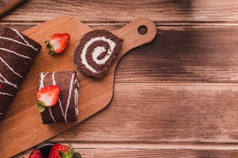 Slices of chocolate dessert on cutting board