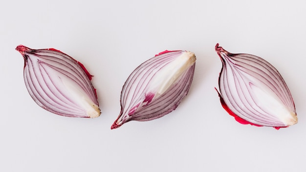 Slices of onion on white background