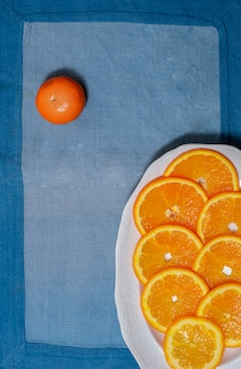 Slices of orange on a blue tablecloth