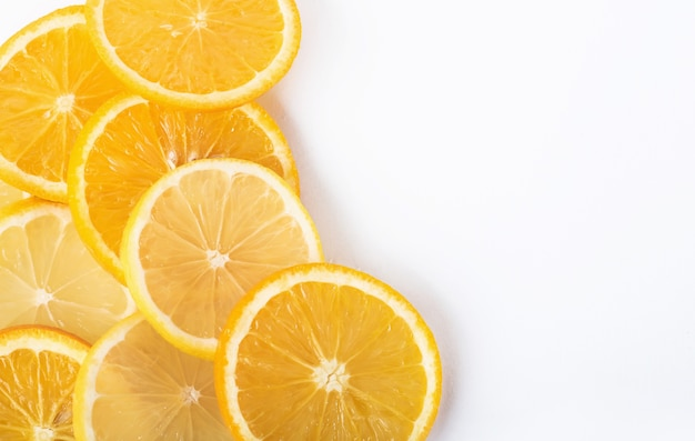Slices of orange and lemon isolated on a white.