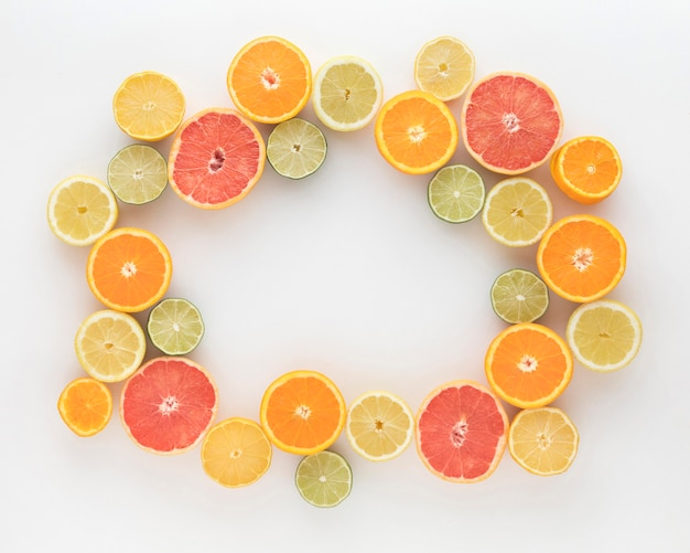 Slices of oranges and lemons top view