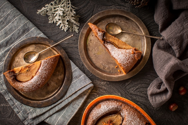 Slices of pear cake on rusty plates