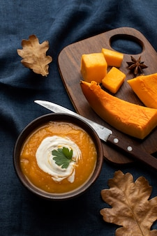 Slices of pumpkin on wooden board high view