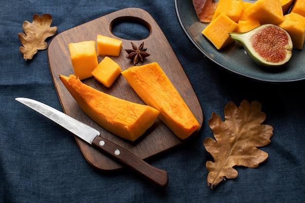 Slices of pumpkin on wooden board
