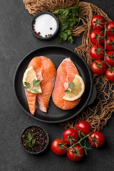 Slices of raw red salmon flat lay