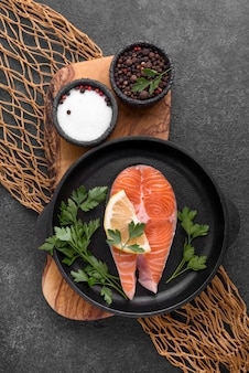 Slices of raw red salmon and herbs