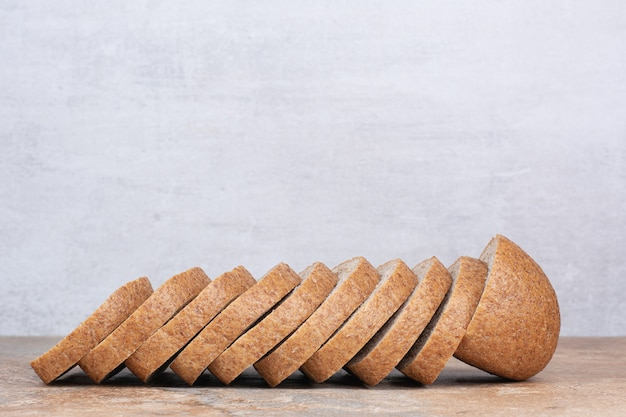 Slices of rye bread on marble table
