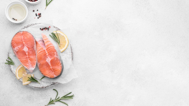 Slices of salmon with lemon copy space