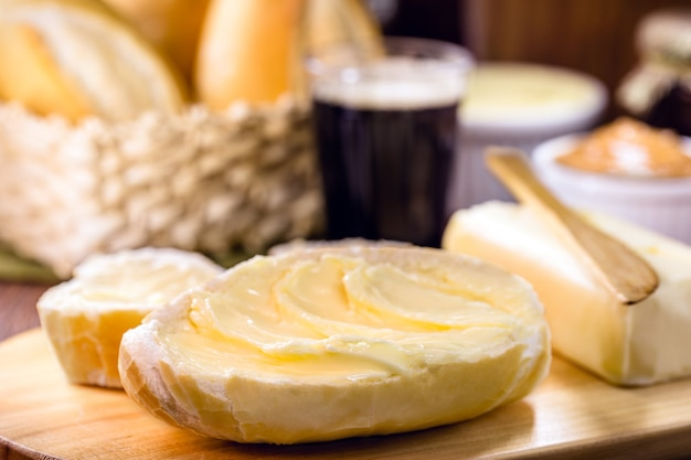 Slices of savory brazilian bread, called french bread, served hot with coffee and lots of butter. brazilian confectionery