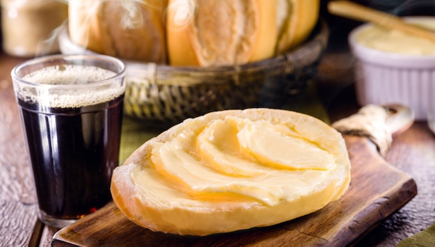 Slices of savory brazilian bread called french bread served hot with coffee and lots of butter