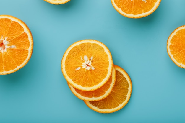 Slices and slices of orange pulp on a bright blue