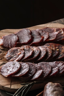 Slices of smoked sausages on board