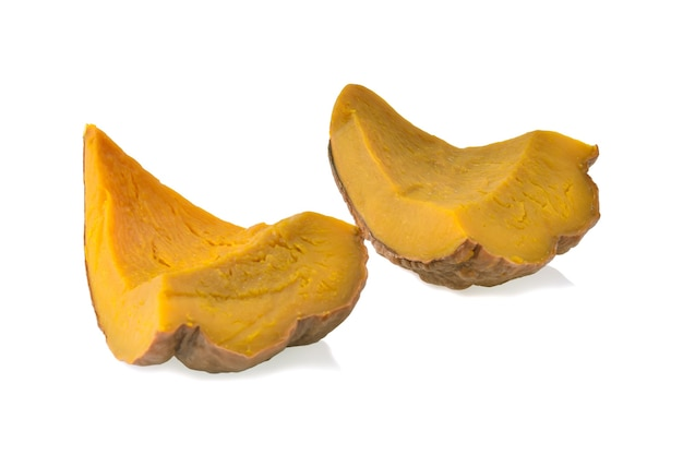 Slices of streamed pumpkin on white background.