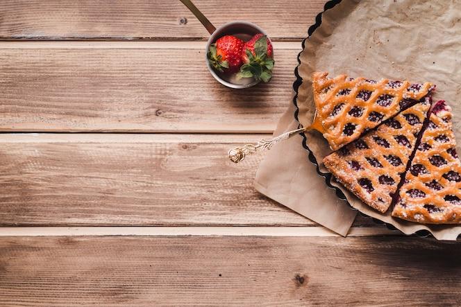 Slices of tasty pie with jam