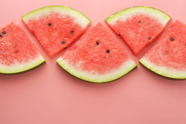 Slices of watermelon isolated on pink background