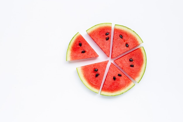 Slices of watermelon isolated on white .