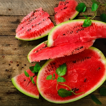 Slices of watermelon with mint leaves on wooden. detox and vegetarian concept.