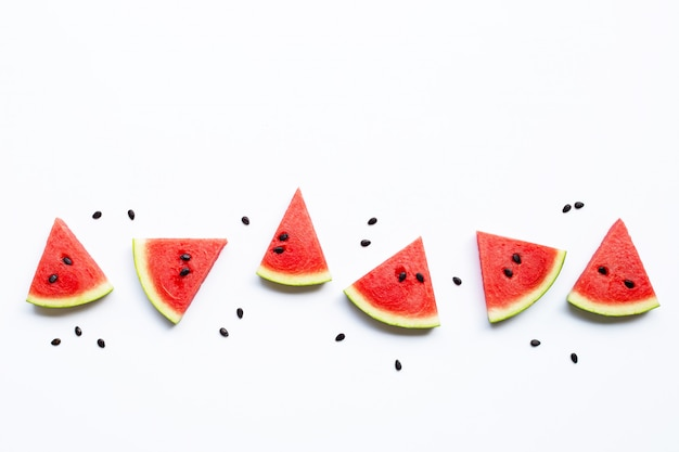 Slices of watermelon with seeds isolated on white