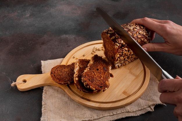 Slicing baked bread with knife
