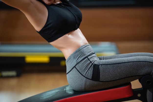 Slide view of fitness woman exercising with  running on treadmill machine in gym.