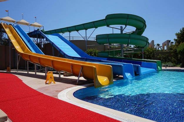 Sliders water park with swimming pool in the hotel on a sunny summer day